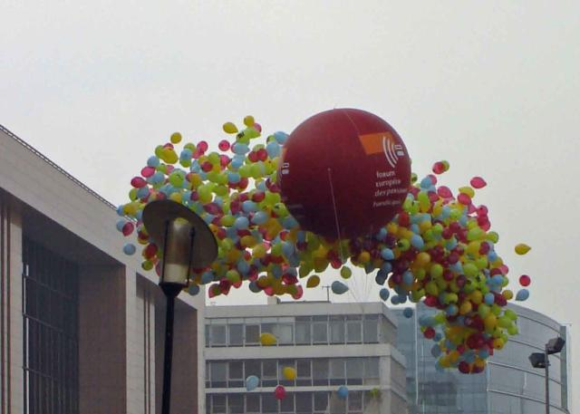 A balloon in the colours of EDF rises above the European Presidency building in Brussels - Picture: Olivier Magritte (click to enlarge) - Enlarge the image
